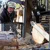 BEN GARVER — THE BERKSHIRE EAGLE<br /> Dicken Crane uses a firewood processor at Holiday Brook Farm in Dalton, Monday, February 11, 2019.  The processor will take a full log, move it, cut it to size and split it all from one series of levers. Crane was working in the afternoon to get as much firewood prepared as possible before the snow.