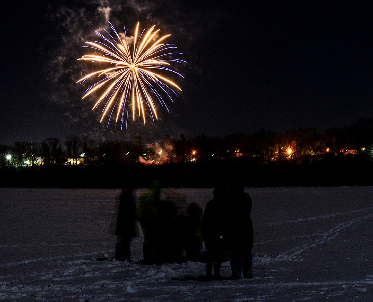 KRISTOPHER RADDER - BRATTLEBORO REFORMER<br /> People brave the subzero temperatures and stand on the frozen waters of the Retreat Meadows to watch Brattleboro's New Year's Eve fireworks on Sunday, Dec. 31, 2017.