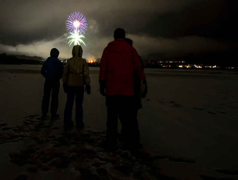 KRISTOPHER RADDER — BRATTLEBORO REFORMER<br /> People gather at the Retreat Meadows, in Brattleboro, Vt., to watch the annual Last Night Brattleboro's fireworks show on Tuesday, Dec. 31, 2019.
