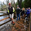 KRISTOPHER RADDER — BRATTLEBORO REFORMER<br /> Buck Rogers, a member of Friends of Pisgah helps lead a group of people on the Doolittle Trail at Pisgah State Park, in Winchester, N.H., during New Hampshire's First Day Hike on Jan. 1, 2019.  Hodge said they saw the event on Facebook and thought it was a beautiful day for a hike.