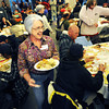 Turkey_3.jpg Volunteer Diane Roberts brings a big plate of food to a guest at Boulder's First Presbyterian Church's annual Thanksgiving Dinner held on November 22, 2012. The church opens it's doors to the homeless, eldery, shut-ins and anyone in need. They expected to serve between 300-350 people.  (Kira Horvath/Daily Camera)