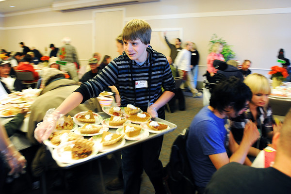 Turkey_5.jpg Volunteer Cole Laurain, 11, races around the packed church hall bringing delicious desserts to guests at Boulder's First Presbyterian Church's annual Thanksgiving Dinner held on November 22, 2012. The church opens it's doors to the homeless, eldery, shut-ins and anyone in need. They expected to serve between 300-350 people.  (Kira Horvath/Daily Camera)