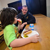 KRISTOPHER RADDER - BRATTLEBORO REFORMER<br /> Brattleboro Fire Fighter Michael Heiden talks with Jaymeson Crochitere during the second annual First Responders BBQ Lunch at Oak Grove Elementary on Wednesday, Feb. 14, 2018.
