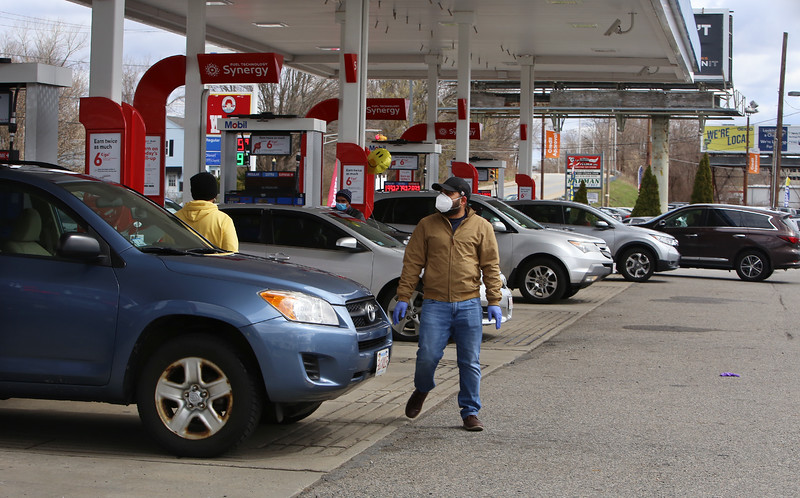 All pumps are busy as Harry's Food Mart Mobil gas station on Middlesex Street  provides free gas on Good Friday to health care workers and first responders. (SUN/Julia Malakie)
