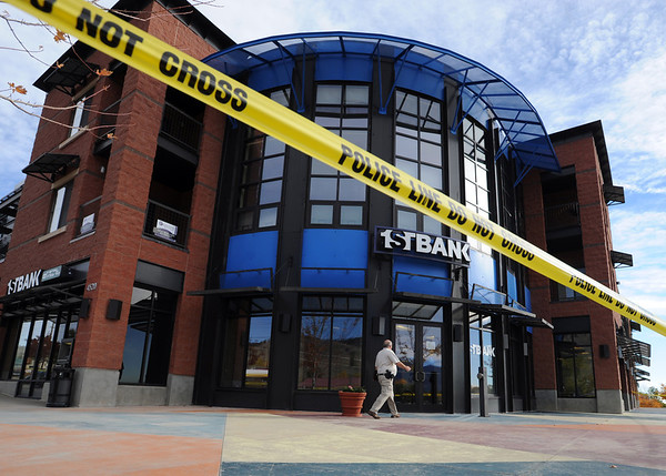 "A Boulder police investigator walks to the scene of a bank robbery on October 19, 2012.<br /> Boulder police are looking for a suspect in a bank robbery at a FirstBank in north Boulder just after 9 a.m. Friday morning.<br /> For more photos and video of the bank, go to  <a href=""http://www.dailycamera.com"">http://www.dailycamera.com</a>.<br /> Cliff Grassmick  / October 19, 2012"