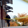 "A Boulder police officer walks around the scene of a bank robbery on October 19, 2012.<br /> Boulder police are looking for a suspect in a bank robbery at a FirstBank in north Boulder just after 9 a.m. Friday morning.<br /> For more photos and video of the bank, go to  <a href=""http://www.dailycamera.com"">http://www.dailycamera.com</a>.<br /> Cliff Grassmick  / October 19, 2012"