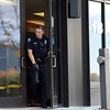 "A Boulder police officer walks from the scene of a bank robbery on October 19, 2012.<br /> Boulder police are looking for a suspect in a bank robbery at a FirstBank in north Boulder just after 9 a.m. Friday morning.<br /> For more photos and video of the bank, go to  <a href=""http://www.dailycamera.com"">http://www.dailycamera.com</a>.<br /> Cliff Grassmick  / October 19, 2012"