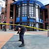 "A Boulder police officer walks to the scene of a bank robbery on October 19, 2012.<br /> Boulder police are looking for a suspect in a bank robbery at a FirstBank in north Boulder just after 9 a.m. Friday morning.<br /> For more photos and video of the bank, go to  <a href=""http://www.dailycamera.com"">http://www.dailycamera.com</a>.<br /> Cliff Grassmick  / October 19, 2012"