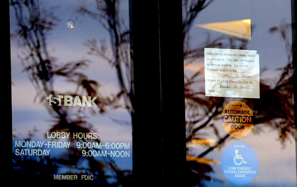 "A note is in the door saying the FirstBank is closed due to an emergency.<br /> Boulder police are looking for a suspect in a bank robbery at a FirstBank in north Boulder just after 9 a.m. Friday morning.<br /> For more photos and video of the bank, go to  <a href=""http://www.dailycamera.com"">http://www.dailycamera.com</a>.<br /> Cliff Grassmick  / October 19, 2012"
