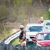 BEN GARVER — THE BERKSHIRE EAGLE<br /> People and cars line the Dan Casey Drive causeway on Onota Lake in Pittsfield in search of the seasons first catch, Tuesday, May 8, 2018.