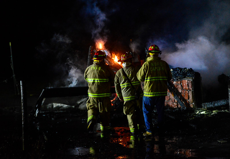 KRISTOPHER RADDER - BRATTLEBORO REFORMER<br /> Firefighters work on containing a five-alarm fire at 185 Maggie Ladd Road on Townshend, Vt., on early Sunday, July 16, 2017. As of 2 a.m., one occupant that lived in the apartment on the second floor of the barn that was on fire was still missing. The cause of the fire is still under investigation.