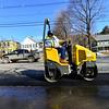 Crews use a hot mix asphalt on Western Avenue to fix the potholes on Tuesday, Feb. 28, 2018.