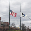 Flags at half staff on Cox Circle in front of Tsongas Center. (SUN/Julia Malakie)