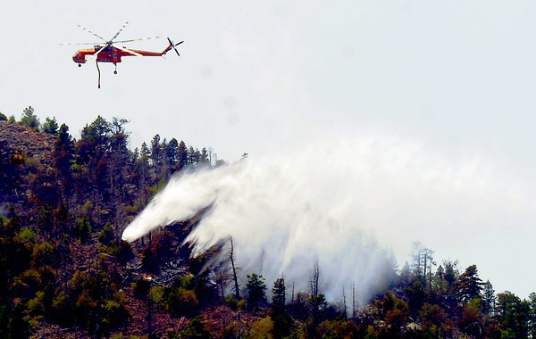 Flagstaff Fire June 29th 73.JPG A firefighter  helicopter makes a water drop on the Flagstaff Fire in Boulder on June 29, 2012.<br />  Cliff Grassmick / June 29, 2012