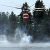 "A helicopter fills up with water at Kossler Lake on Friday, June 29, during the Flagstaff Fire in Boulder. For a video interview with firefighters go to  <a href=""http://www.dailycamera.com"">http://www.dailycamera.com</a><br /> Jeremy Papasso/ Camera"