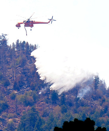 Flagstaff Fire June 29th 43.JPG A firefighter  helicopter makes a water drop on the Flagstaff Fire in Boulder on June 29, 2012.<br />  Cliff Grassmick / June 29, 2012
