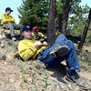 "Rocky Mountain Fire crew members Dana Lewis, front, Andy Tombolato Jessey Zerfoss and Craig Holm stand watch on Bison Road on Friday, June 29, during the Flagstaff Fire in Boulder. For a video interview with firefighters go to  <a href=""http://www.dailycamera.com"">http://www.dailycamera.com</a><br /> Jeremy Papasso/ Camera"