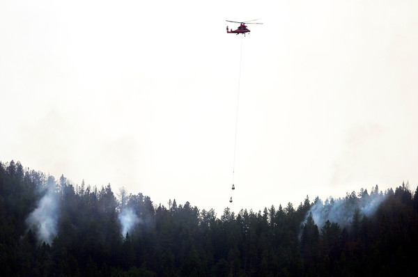 "A helicopter works to put out the still smoldering Flagstaff Fire on Friday, June 29, near Bison Road in Boulder. For a video interview with firefighters go to  <a href=""http://www.dailycamera.com"">http://www.dailycamera.com</a><br /> Jeremy Papasso/ Camera"