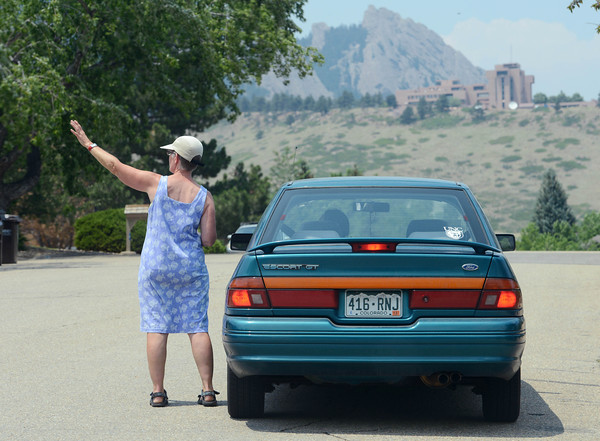 Flagstaff Fire June 29th 84.jpg Jackie Jimmerson, pointing, and her friend, Frances DeHerrera, watch the helicopter water drops from the homes west of Lehigh in Boulder on June 29, 2012.<br />  Cliff Grassmick / June 29, 2012