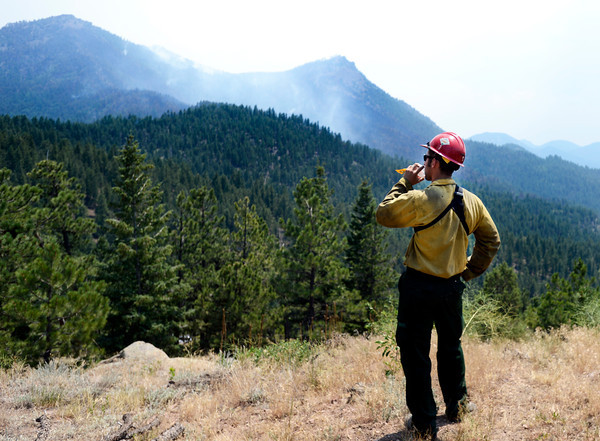 "Rocky Mountain Fire firefighter Jessey Zerfoss stands watch on Bison Road on Friday, June 29, during the Flagstaff Fire in Boulder. For a video interview with firefighters go to  <a href=""http://www.dailycamera.com"">http://www.dailycamera.com</a><br /> Jeremy Papasso/ Camera"