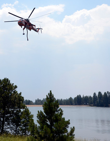 "A helicopter departs Kossler Lake after filling up while fighting the fire on Friday, June 29, during the Flagstaff Fire in Boulder. For a video interview with firefighters go to  <a href=""http://www.dailycamera.com"">http://www.dailycamera.com</a><br /> Jeremy Papasso/ Camera"