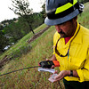 Keith Hancock, of the Left Hand Fire department takes measurements from near the trail head at the base of Cragmoor Road. Fire trucks have gathered to work on the fire line break to protect the neighborhoods in South Boulder, Colorado. June 28, 2012. Rachel Woolf/ For the Daily Camera