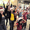 "BE1216flash11<br /> Ashley Sullivan, 17, left, and Brooke Jones, 16, dancers with Artistic Fusion Dance Academy, helped lead a flash mob of over 200 people dancing to Mariah Carey's song ""All I want for Christmas is you"" surrounding shoppers in the food court of FlatIron Crossing mall on Thursday. <br /> December  9, 2010<br /> staff photo/David R. Jennings"