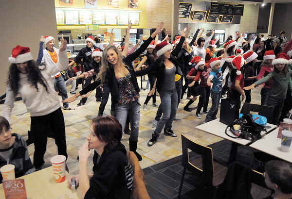 "BE1216flash05<br /> Dancers from Artistic Fusion Dance Academy and  Break EFX  formed a flash mob of over 200 people dancing to Mariah Carey's song ""All I want for Christmas is you"" in the food court of FlatIron Crossing mall on Thursday. <br /> December  9, 2010<br /> staff photo/David R. Jennings"