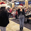 "BE1216flash18<br /> Ashley Sullivan, 16, center, and fellow Artistic Fusion Dance Academy dancers perform as other dancers wait to begin dancing in a flash mob of over 200 people dancing to Mariah Carey's song ""All I want for Christmas is you"" surrounding shoppers in the food court of FlatIron Crossing mall on Thursday. Dancers from Break EFX participated in the flash mob.<br /> December  9, 2010<br /> staff photo/David R. Jennings"
