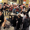 "BE1216flash06<br /> Dancers from Artistic Fusion Dance Academy and  Break EFX  formed a flash mob of over 200 people dancing to Mariah Carey's song ""All I want for Christmas is you"" surrounding shoppers in the food court of FlatIron Crossing mall on Thursday. <br /> December  9, 2010<br /> staff photo/David R. Jennings"