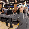 "BE1216flash01<br /> Break EFX dancer Hannah Vincent begins dancing leading over 200 people to dance in a flash mob to Mariah Carey's song ""All I want for Christmas is you"" in the food court of FlatIron Crossing mall on Thursday. Dancers in the flash mob were from Artistic Fusion Dance Academy and Break EFX Boulder/Denver. <br /> December  9, 2010<br /> staff photo/David R. Jennings"