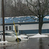 KRISTOPHER RADDER — BRATTLEBORO REFORMER<br /> Cars and homes start to get flooded at the Mountain Home Park as water breached the banks of the Whetstone Brook.
