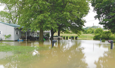 JONATHAN DELOZIER / GAZETTE Rittman fire Chief Don Sweigert said Monday this is the worst flooding seen in the city in more than a decade.