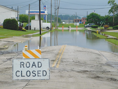 JONATHAN DELOZIER / GAZETTE The Rittman Fire Department fielded six calls Monday involving vehicles attempting to pass through high water. A road closed sign on a roadway alerts drivers not to drive through high waters.