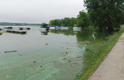 JONATHAN DELOZIER / GAZETTE Flooding in Chippewa Lake Monday reaches to just inches from the shoreline neighborhood.
