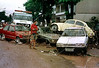 Residents watch a damaged cars by floods in Jacarepagua, outskirts of Rio de Janeiro, Brazil, February 14, 1996. Brazilian officials said the death toll from floods and mudslides in Rio has risen to more than 80. (Austral Foto/Renzo Gostoli)