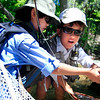 (From right) Braneon Roberts, 10, and Allan Sease, 12, show off a fish caught by Roberts in Boulder Creek near Eben G. Fine Park on Friday, July 16, during their fly fishing class through Thorne Nature Science School.<br /> Greg Lindstrom / The Camera