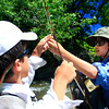 Braneon Roberts (left), 10, and Allan Sease, 12, untangle a line in Boulder Creek near Eben G. Fine Park on Friday, July 16, during their fly fishing class through Thorne Nature Science School.<br /> Greg Lindstrom / The Camera