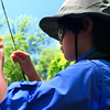 Allan Sease, 12, ties on an indicator while fishing Boulder Creek near Eben G. Fine Park on Friday, July 16, during his fly fishing class through Thorne Nature Science School.<br /> Greg Lindstrom / The Camera