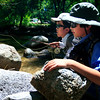 (From left) Braneon Roberts, 10, and Allan Sease, 12, watch for strikes in Boulder Creek near Eben G. Fine Park on Friday, July 16, during their fly fishing class through Thorne Nature Science School.<br /> Greg Lindstrom / The Camera