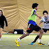 "Leroy Alphonse, 14, center, dribbles the ball past Jesus Cervantes, 15, on Sunday, Dec. 18, during a Football Club Boulder pick-up soccer game at the University of Colorado's Athletic Bubble just north of Folsom Field on the CU campus in Boulder. The two club teams BC Force and the Boulder Athletic have merged teams to diversify and bring all Boulder County ethnicities together. For more photos and video  of the event go to  <a href=""http://www.dailycamera.com"">http://www.dailycamera.com</a><br /> Jeremy Papasso/ Camera"