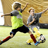 "Arroll Takla, 9, left, tries to steal the ball from Mackenzie Burns, 9, on Sunday, Dec. 18, during a Football Club Boulder pick-up soccer game at the University of Colorado's Athletic Bubble just north of Folsom Field on the CU campus in Boulder. The two club teams BC Force and the Boulder Athletic have merged teams to diversify and bring all Boulder County ethnicities together. For more photos and video  of the event go to  <a href=""http://www.dailycamera.com"">http://www.dailycamera.com</a><br /> Jeremy Papasso/ Camera"