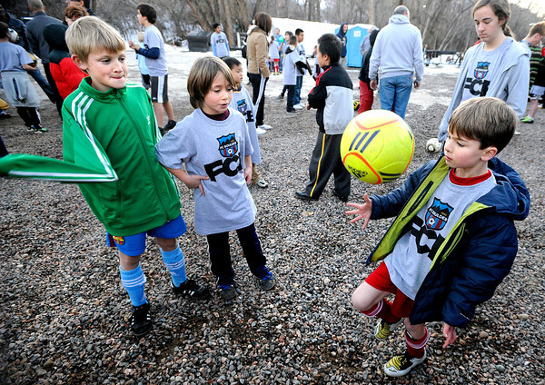 "Noah Vrencur, 9, left, and Isaac Sherman, 9, watch as Hayden Miller, 8, knees the soccer ball on Sunday, Dec. 18, during a Football Club Boulder pick-up soccer game at the University of Colorado's Athletic Bubble just north of Folsom Field on the CU campus in Boulder. The two club teams BC Force and the Boulder Athletic have merged teams to diversify and bring all Boulder County ethnicities together. For more photos and video  of the event go to  <a href=""http://www.dailycamera.com"">http://www.dailycamera.com</a><br /> Jeremy Papasso/ Camera"