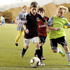 "Noah Hubbard, 9, left, and Jake Steves, 9, fight for the ball on Sunday, Dec. 18, during a Football Club Boulder pick-up soccer game at the University of Colorado's Athletic Bubble just north of Folsom Field on the CU campus in Boulder. The two club teams BC Force and the Boulder Athletic have merged teams to diversify and bring all Boulder County ethnicities together. For more photos and video  of the event go to  <a href=""http://www.dailycamera.com"">http://www.dailycamera.com</a><br /> Jeremy Papasso/ Camera"