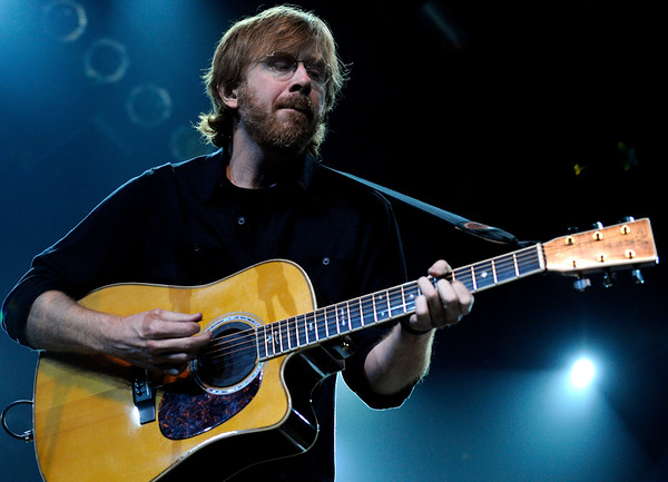 "Trey Anastasio, of Phish, sings some tunes with fellow band member Mike Gordon, not pictured, on Saturday, Oct. 9, during the Fourmile Fire benefit concert at the 1st Bank Center in Broomfield.<br /> For more photos go to  <a href=""http://www.dailycamera.com"">http://www.dailycamera.com</a><br /> Photo by Jeremy Papasso/ Camera"