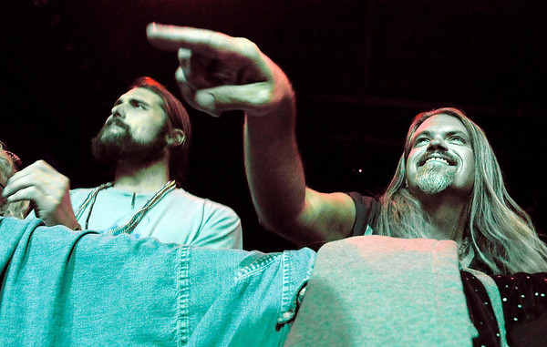 """Jeff Grantham, right, and Tyler Herald jam out to the music of the Yonder Mountain String Band on Saturday, Oct. 9, during the Fourmile Fire benefit concert at the 1st Bank Center in Broomfield.<br /> For video go to  <a href=""""http://www.dailycamera.com"""">http://www.dailycamera.com</a><br /> Photo by Jeremy Papasso/ Camera"""