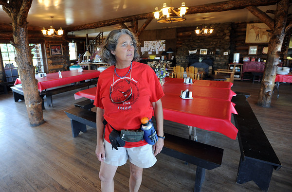 """Lynn Walker was thankful the the main guest lodge survived the fire.<br /> Mike and Lynn Walker of Colorado Mountain Ranch lost their home and other buildings in the Four Mile Canyon Fire.<br /> For a video and photos of Colorado Mountain Ranch, go to  <a href=""""http://www.dailycamer.com"""">http://www.dailycamer.com</a>.<br /> Cliff Grassmick / August 26, 2011"""