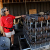 "Lynn Walker shows the numerous horseshoes that were recovered after the fire last year.<br /> Mike and Lynn Walker of Colorado Mountain Ranch lost their home and other buildings in the Four Mile Canyon Fire.<br /> For a video and photos of Colorado Mountain Ranch, go to  <a href=""http://www.dailycamer.com"">http://www.dailycamer.com</a>.<br /> Cliff Grassmick / August 26, 2011"