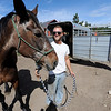 "Molly the horse, held by Tyler Stites, was one of the 30-plus ranch horses that were evacuated during last year's fire.<br /> Mike and Lynn Walker of Colorado Mountain Ranch lost their home and other buildings in the Four Mile Canyon Fire.<br /> For a video and photos of Colorado Mountain Ranch, go to  <a href=""http://www.dailycamer.com"">http://www.dailycamer.com</a>.<br /> Cliff Grassmick / August 26, 2011"