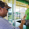 Globe/T. Rob Brown<br /> T.J. Brown of Granby purchases a pineapple whip Friday morning, July 19, 2013, from Davis Tolbert, 17, with Pineapple Whip, during the Four State Farm Show near Pittsburg, Kan.